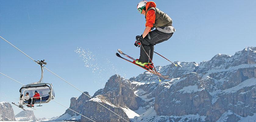 italy_dolomites_val-di-fassa_skier_jump.jpg
